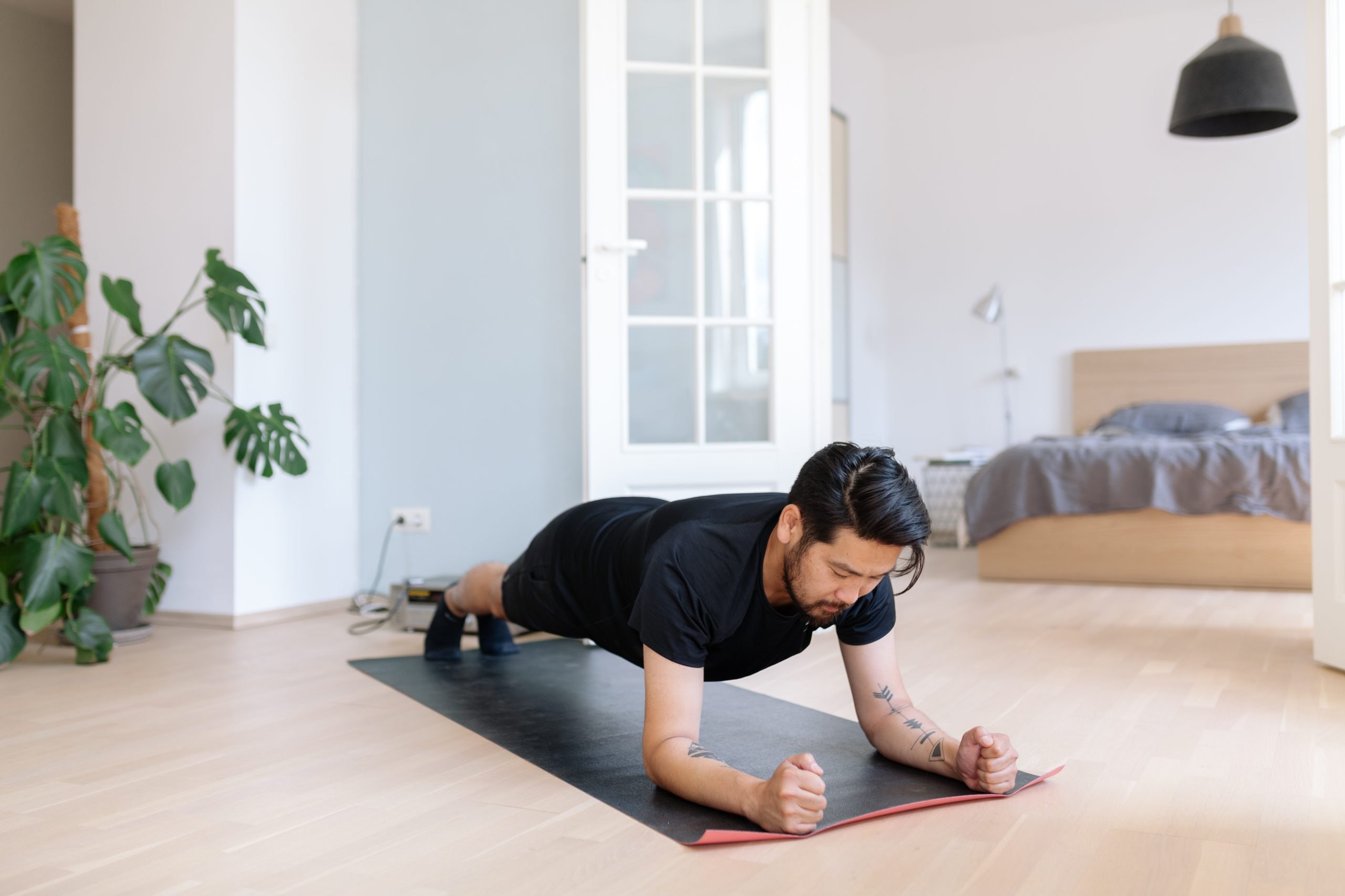Asian man does planking exercise at home