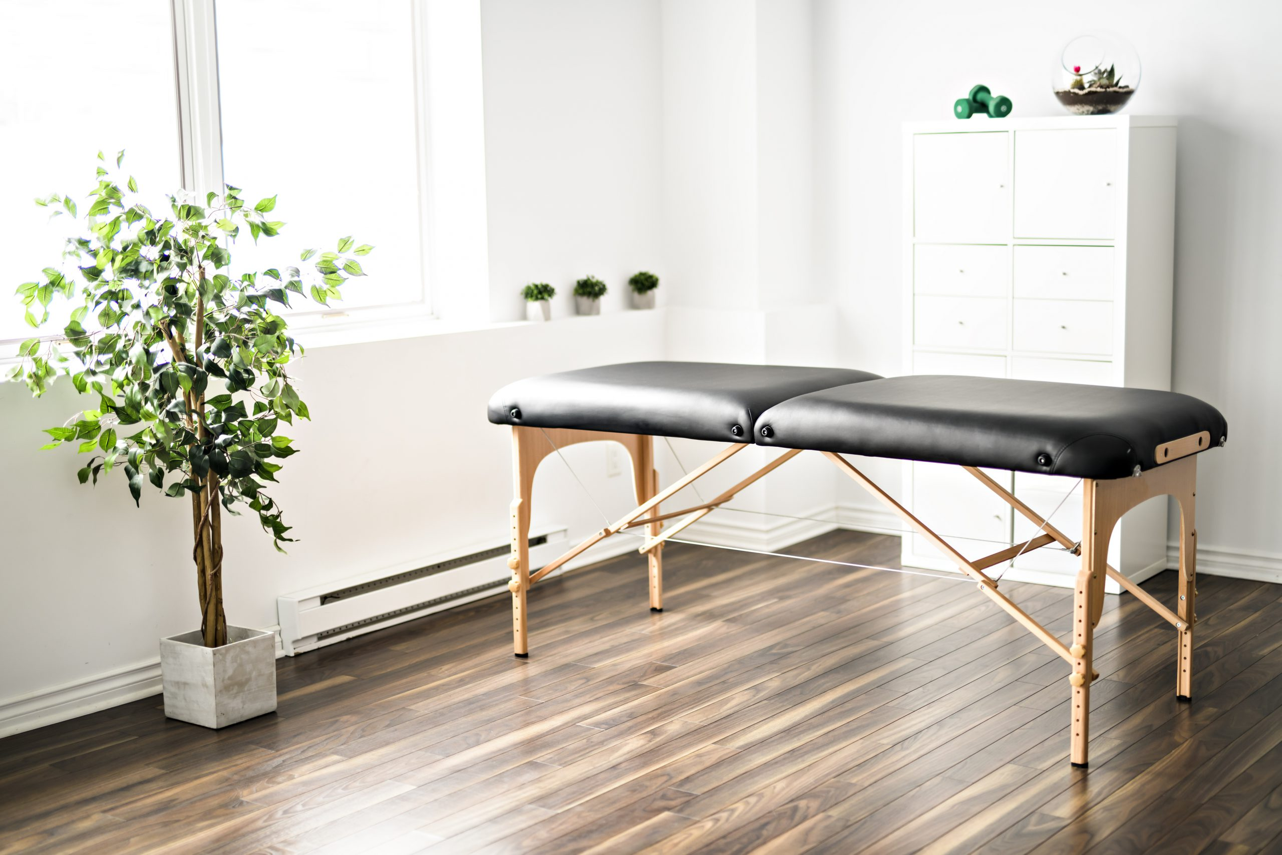 A physiotherapy room with table at work